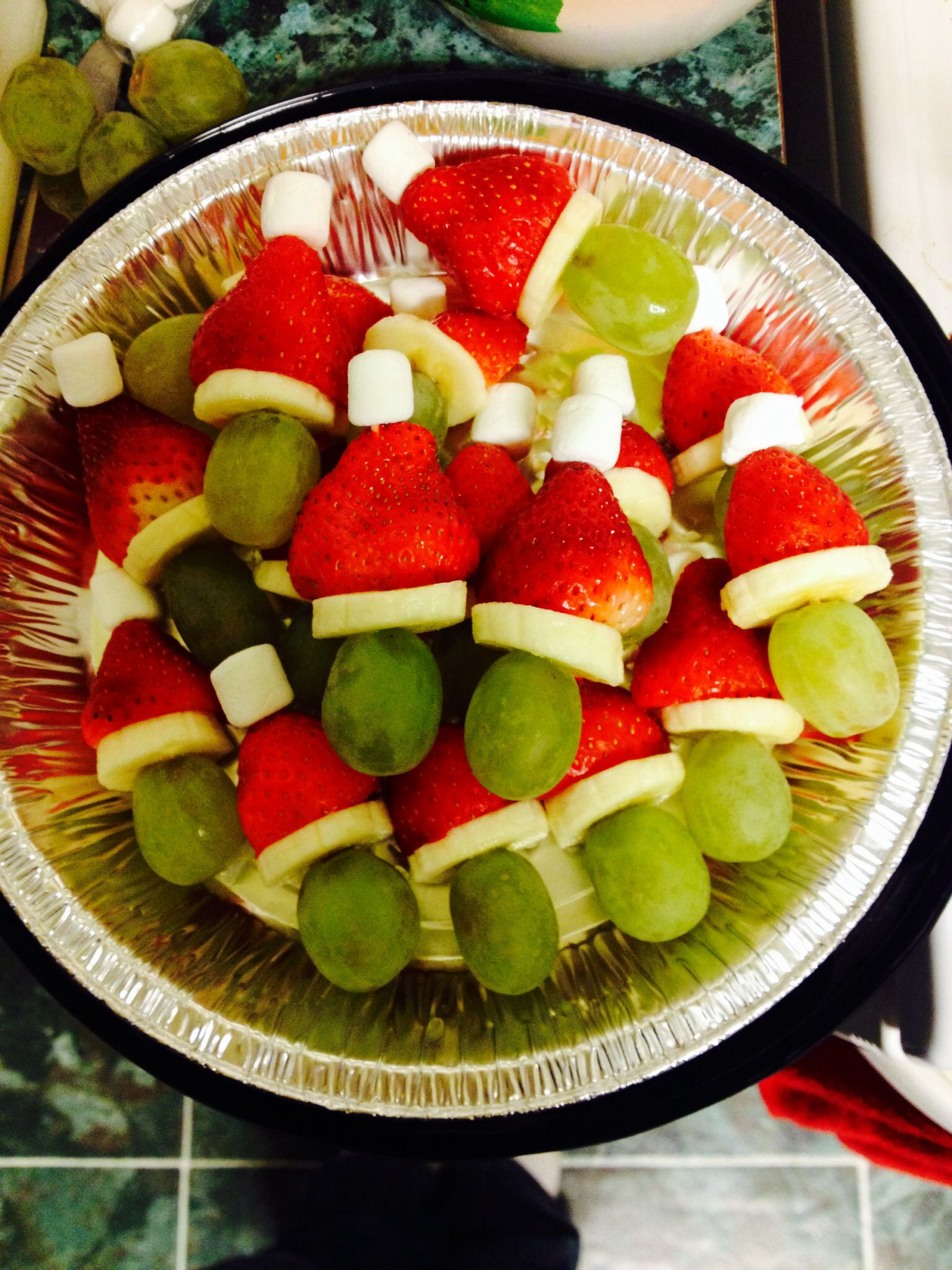Grinch kabobs- soak the banana slices for a few minutes in orange juice and they will not brown for a few hours in the fridge!
