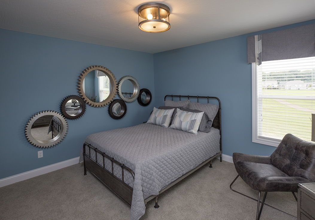 Guest Bedroom With Blue Wall Paint And Beige Carpet Rockford Home J E Evans Photography Carpet Beige Carpet Bedroom Blue Bedroom Walls Bedroom Carpet