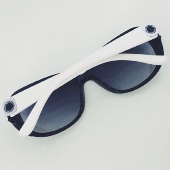 fdf1cfb32 Marc by Marc Jacobs Sunglasses Style # MMJ 150/S OVF9C. Black and white  resin Marc by Marc Jacobs oversize sunglasses with silver-tone logo at  temples.