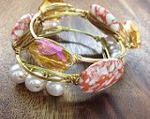 The Giana Stacklette: $38.50. A set of 3 wire wrapped bangles. Available in Gold, Rose Gold or Silver. Standard and Custom Sizes available. The perfect, unique gift for bridesmaids, maid of honor, mothers day, birthdays and any special occasion.