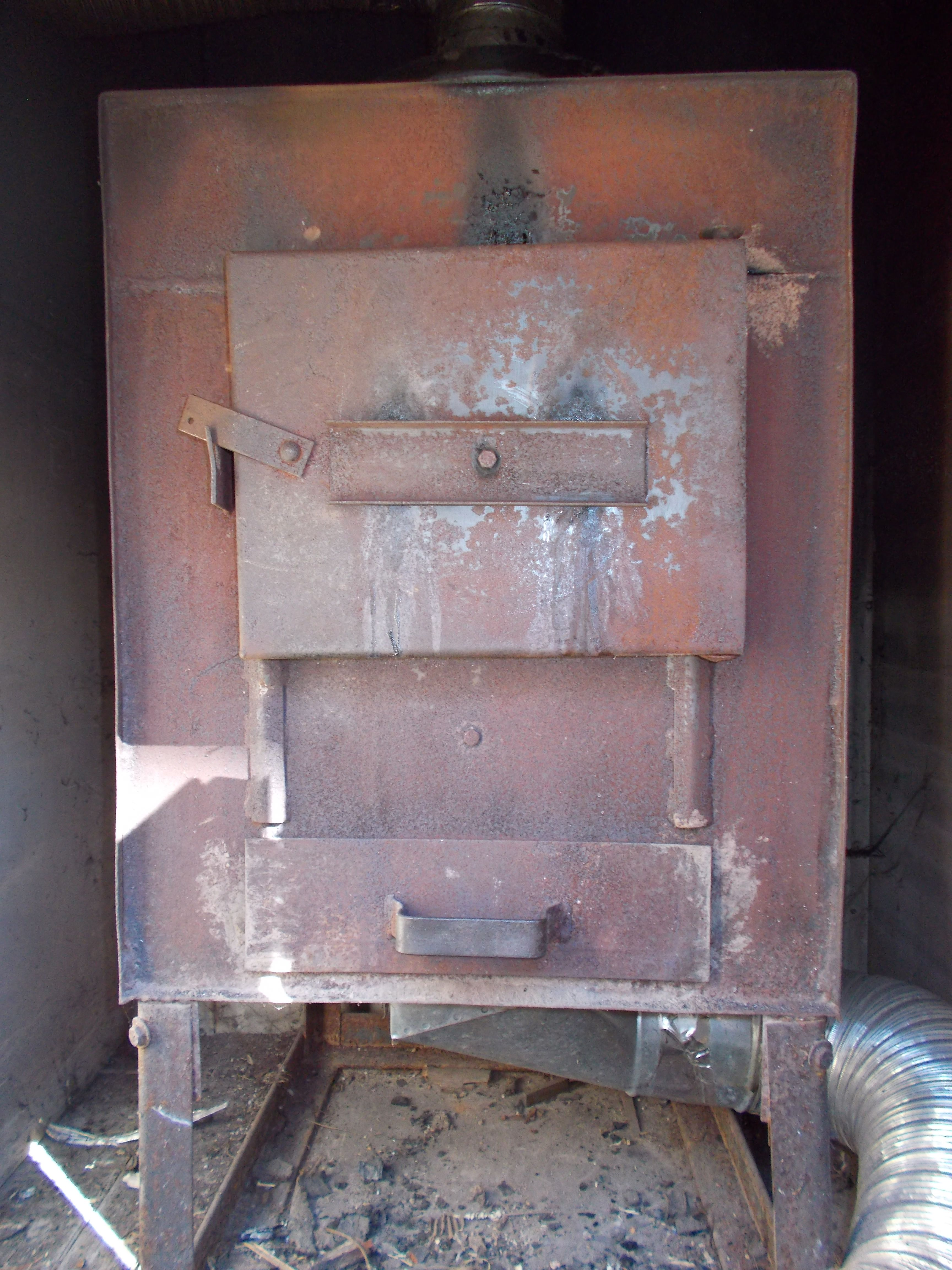 "The second hand wood stove box inside the ""red shed"", part"