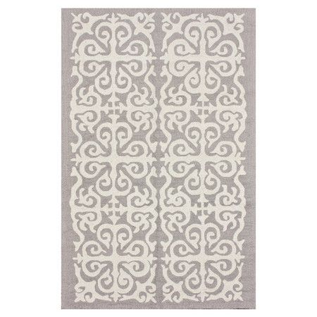 Hand-hooked wool rug with a scrollwork medallion motif.  Product: RugConstruction Material: 100% Wool