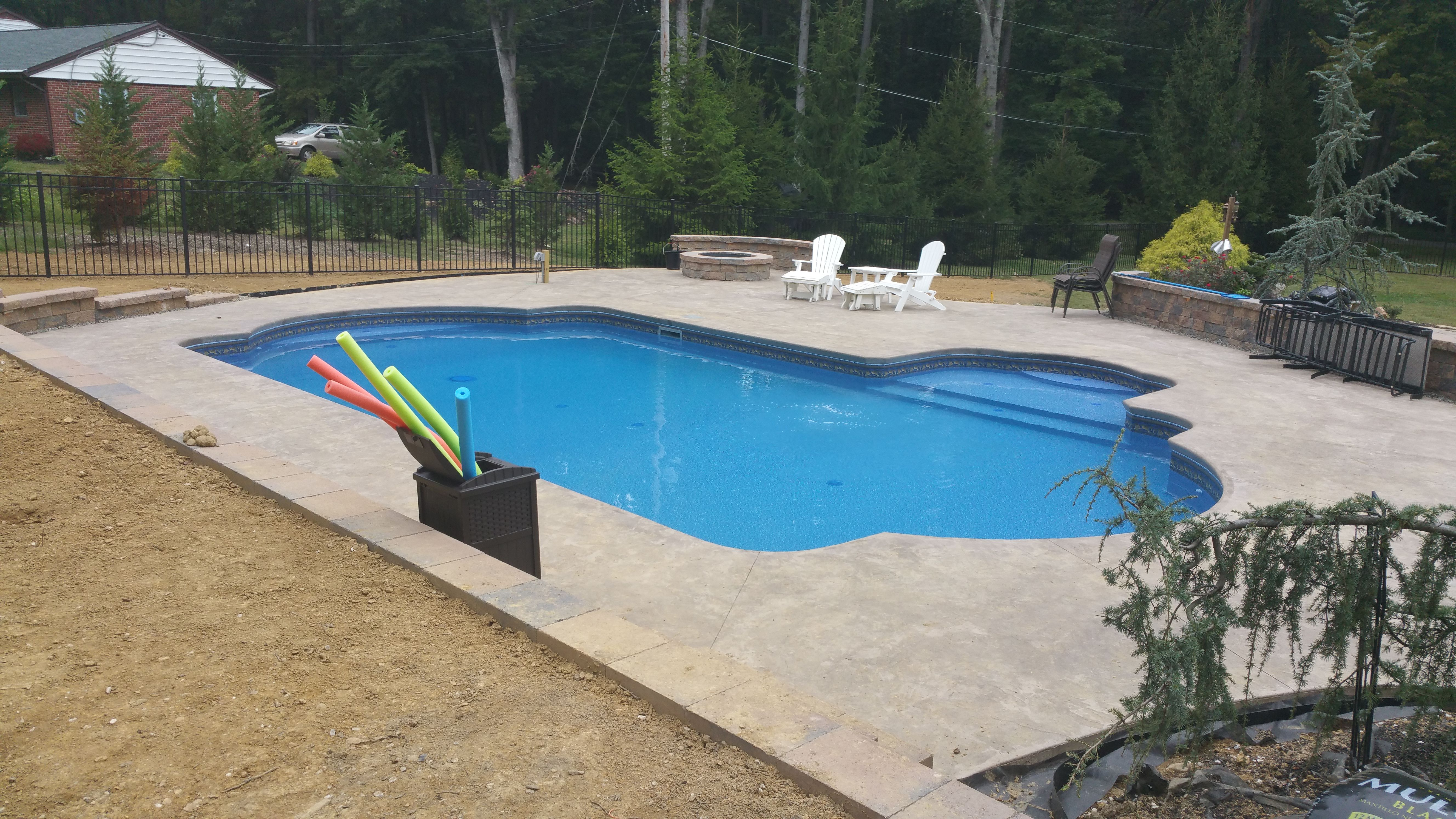 Vinyl Liner Pool With Tanning Ledge Cantilever Decking Retaining Wall Sitting Wall Floor Cleaning System Stamped Conc Pool Vinyl Pool Fire Pit Landscaping