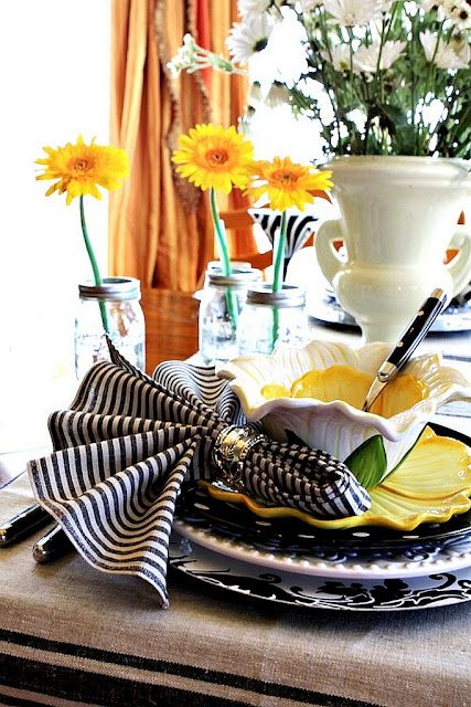 black and white tablescape with a bright splash of color