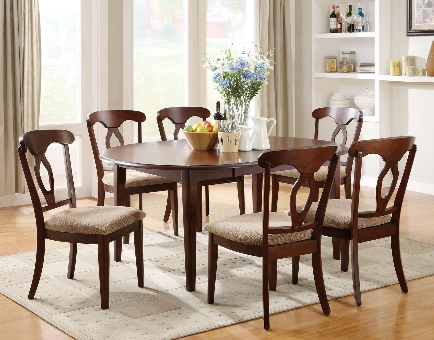 accommodate an array of dinner party sizes with this versatile oval dining table - Wooden Dining Table With Chairs