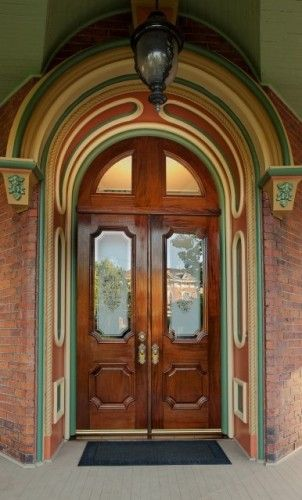 Stunning Stained Wood Front Door Set Off By Fabulous Arched Transom And Trim Exterior Doors Custom Door Unique Doors
