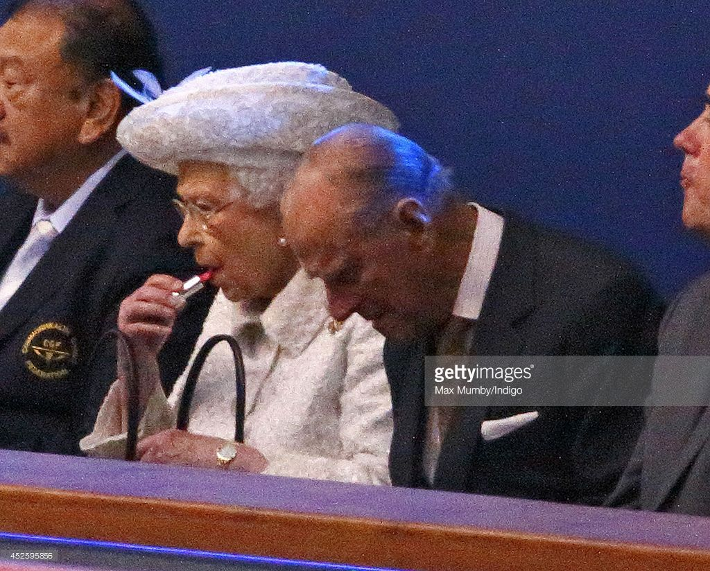 BEST QUALITY AVAILABLE) Queen Elizabeth II puts on her lip stick as she and Prince Philip, Duke of Edinburgh attend the Opening Ceremony for the Glasgow 2014 Commonwealth Games at Celtic Park on July 23, 2014 in Glasgow, Scotland.