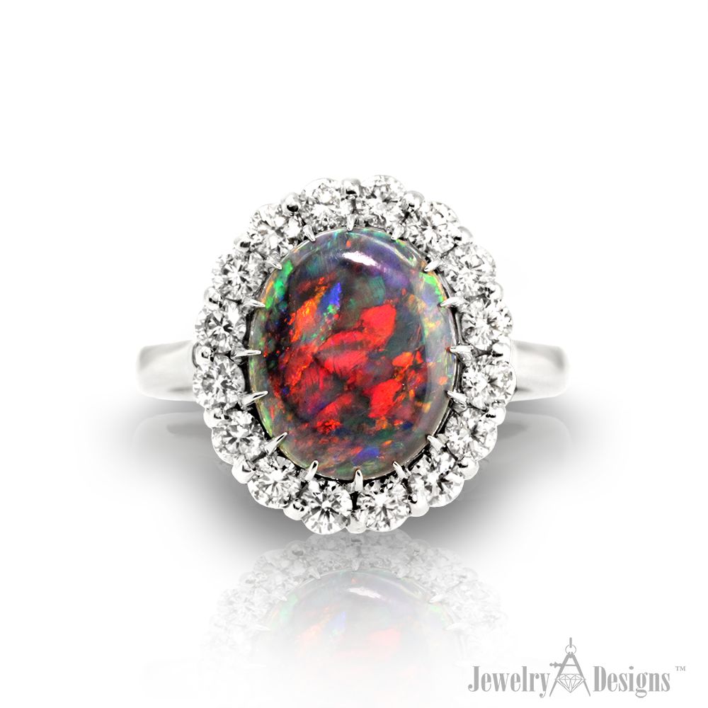 Among the rarest of gems, this black opal features intense red harlequin patterns