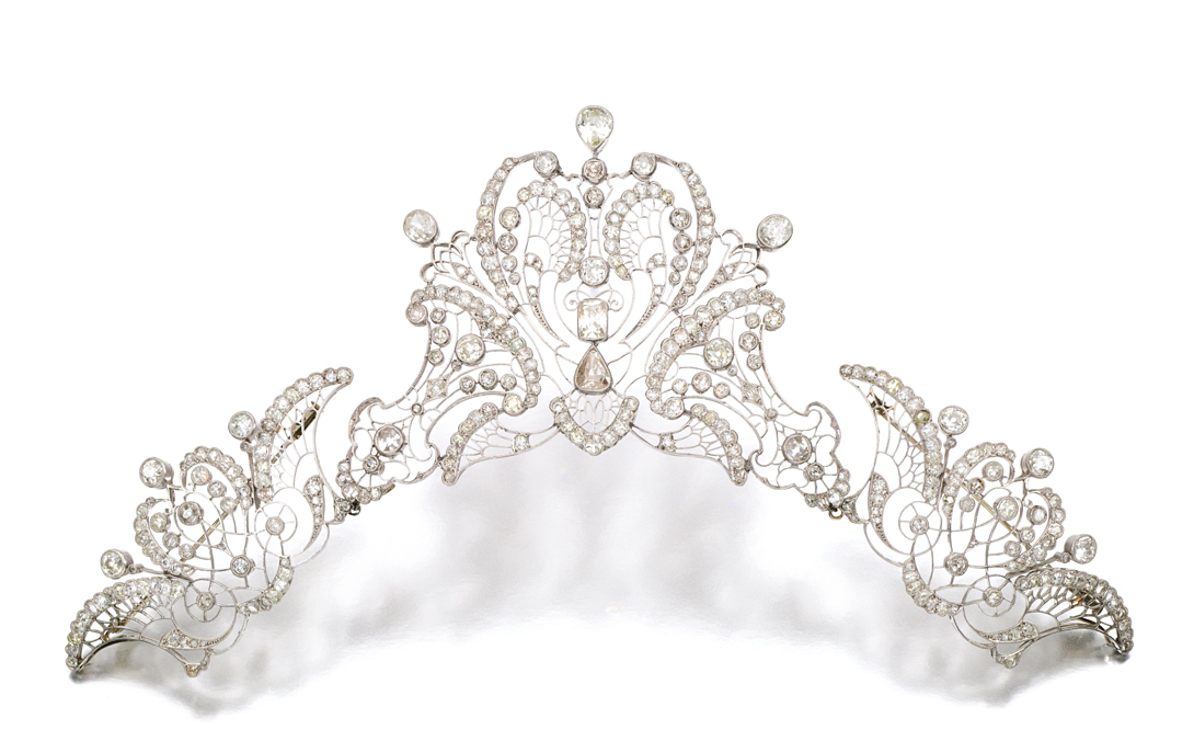DIAMOND TIARA/ DEVANT DE CORSAGE, CIRCA 1910 Of openwork scroll and foliate design, set with circular-, mixed-cut and rose diamonds, detachable into three sections with brooch fittings, tiara frame deficient.