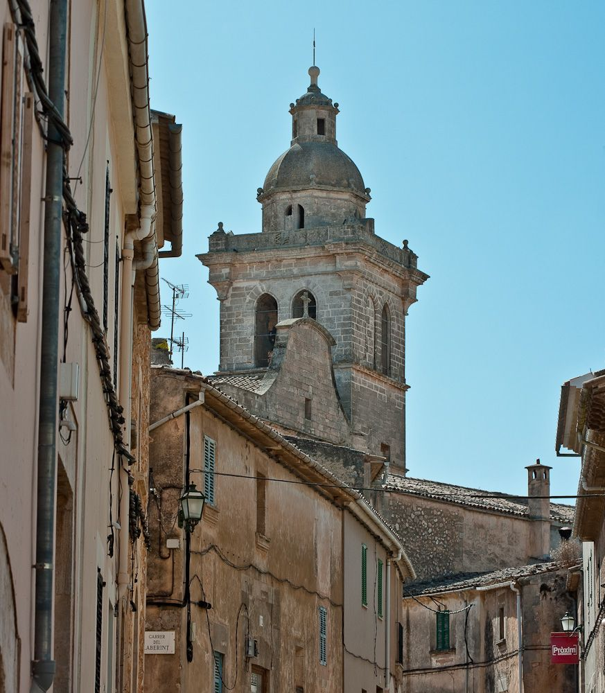 Church tower Algaida (Mallorca) / The Peter and Paul Church in the 13th Century built by the Catalan conquerors with a portal style in Roman-Byzantine ..