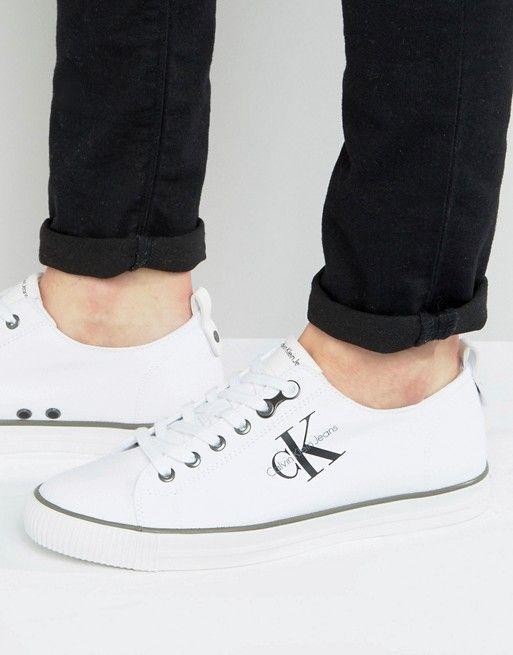 9c759125fb1 Calvin Klein Arnold Logo low top plimsolls in white | asos men ...