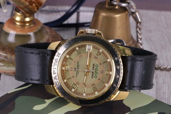 Soviet watch, Cardi WOSTOK Capitan, men's watch CARDI Vostok, Russian wrist watch, rare watch, mechanical watch, Wostok watch, Vintage watch. This watch is made by collaboration of the famous Soviet watch brand VOSTOK and Russian watch brand CARDI in Russia in 1991 - 1995 years.Rare, wrist watch for collection or everyday use. Hurry up! Quantity limited!MEASURES%=================== -Mechanical watch- Central second hand- Case size with crown 40 mm- Case size without crown 37 mm- Strap leather 18