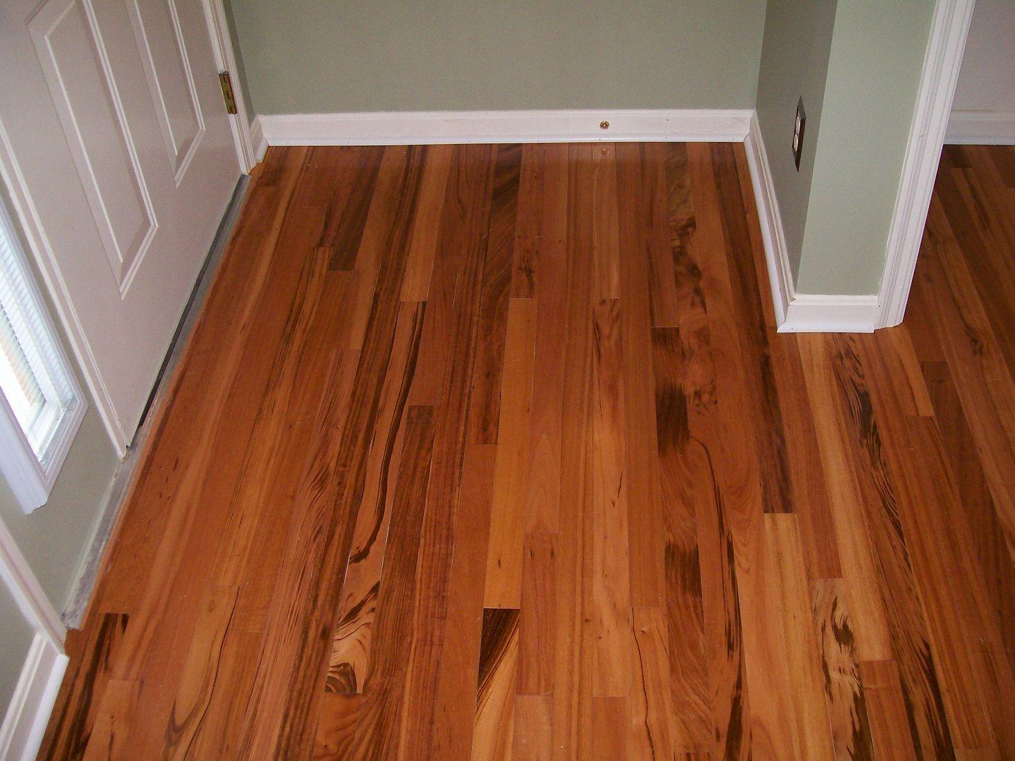 laying laminate flooring around bottom stairs