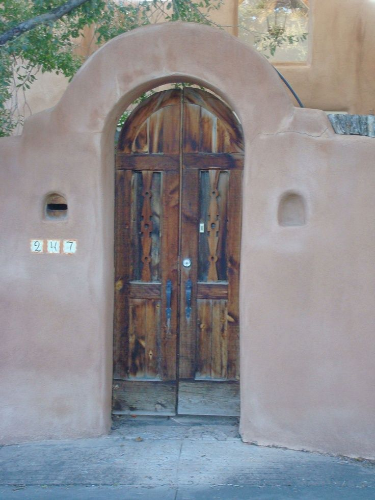 New Mexican doorways, for their spiritual paths keep out