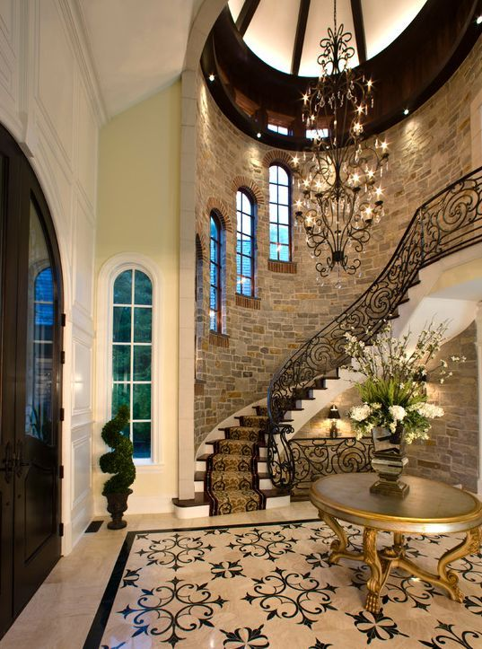 Traditional Entryway With Chandelier Complex Marble Tile