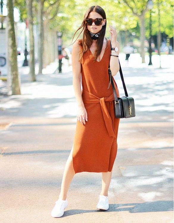 ecf04789f8f A v-neck burnt orange midi dress is worn with white tennis shoes