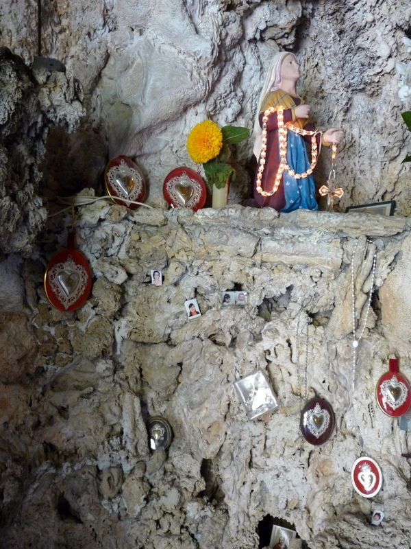 #Altar in a small #cave in the #Alpi #Liguri, #Liguria #Italy with candles, lights, statues and pictures of the beloved that have passed away
