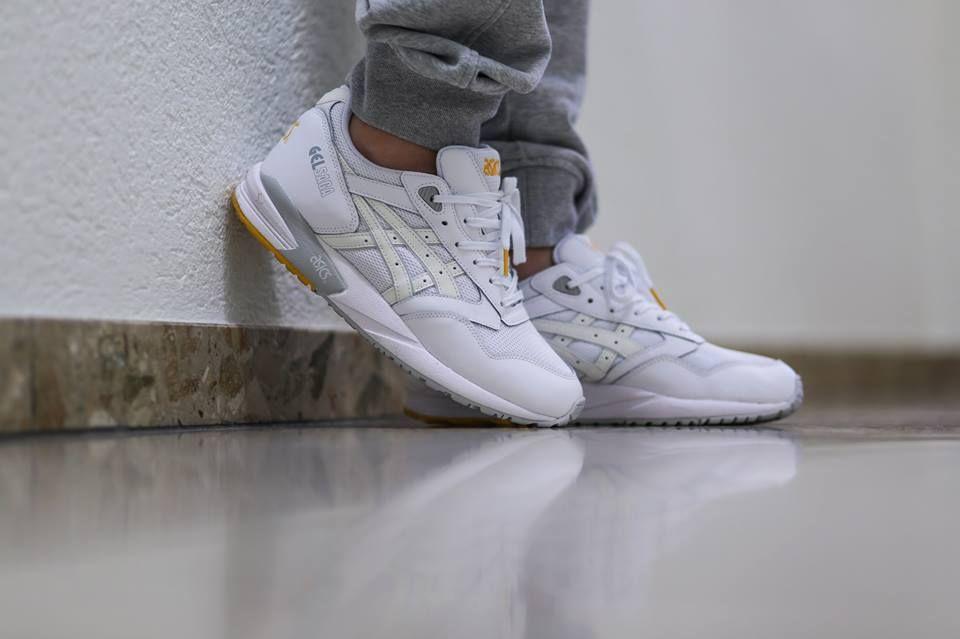 all white asics on feet