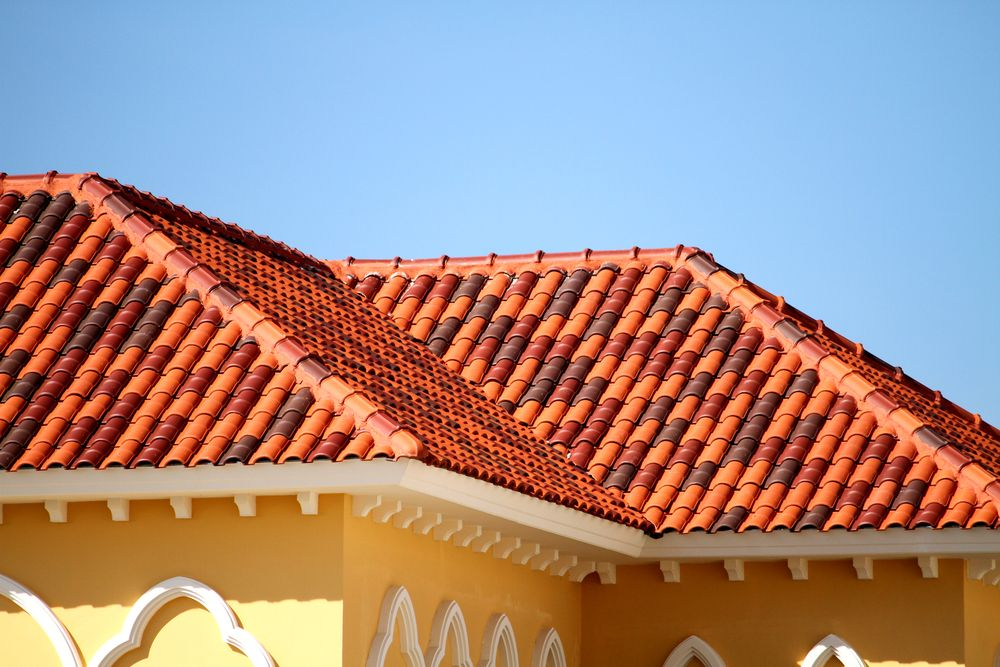 These Spanish Tiles Look Amazing On This Roof Replacement Terracotta Roof Caribbean Real Estate Roof Restoration