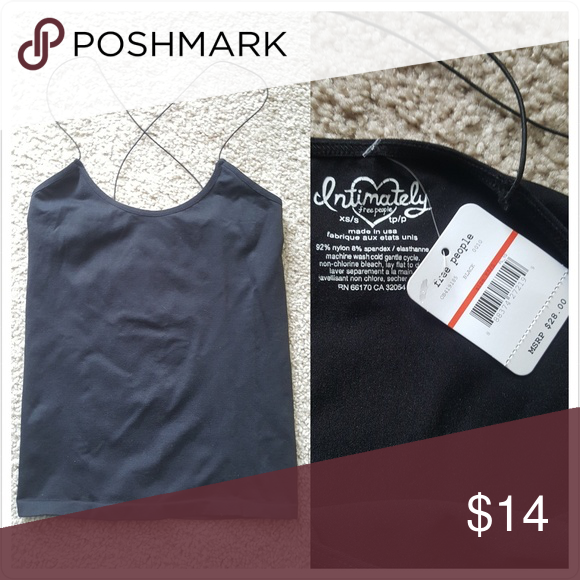 NWT Free People Cami Tank Top New with tag  Retail $28.00 Part of the Intimately Free People line  Black cami Thin straps that cross in the back Size XS Free People Tops