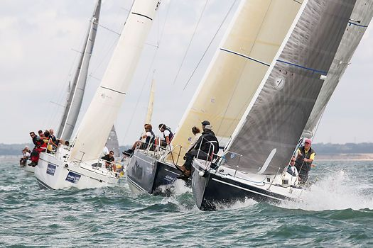 The J/105 yacht 'King Louie' at the start of a race during Cowes Week 2014.