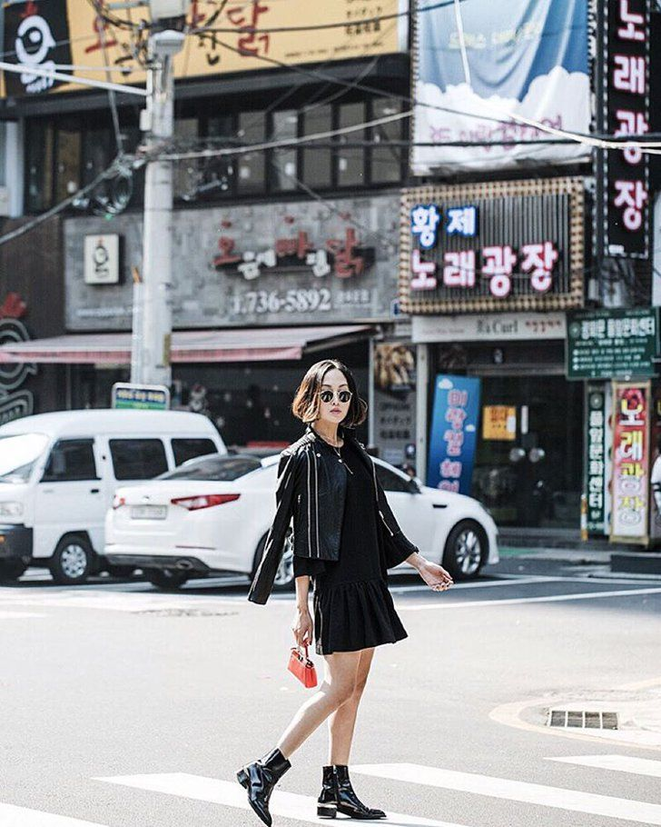With a Leather Jacket and Black Booties