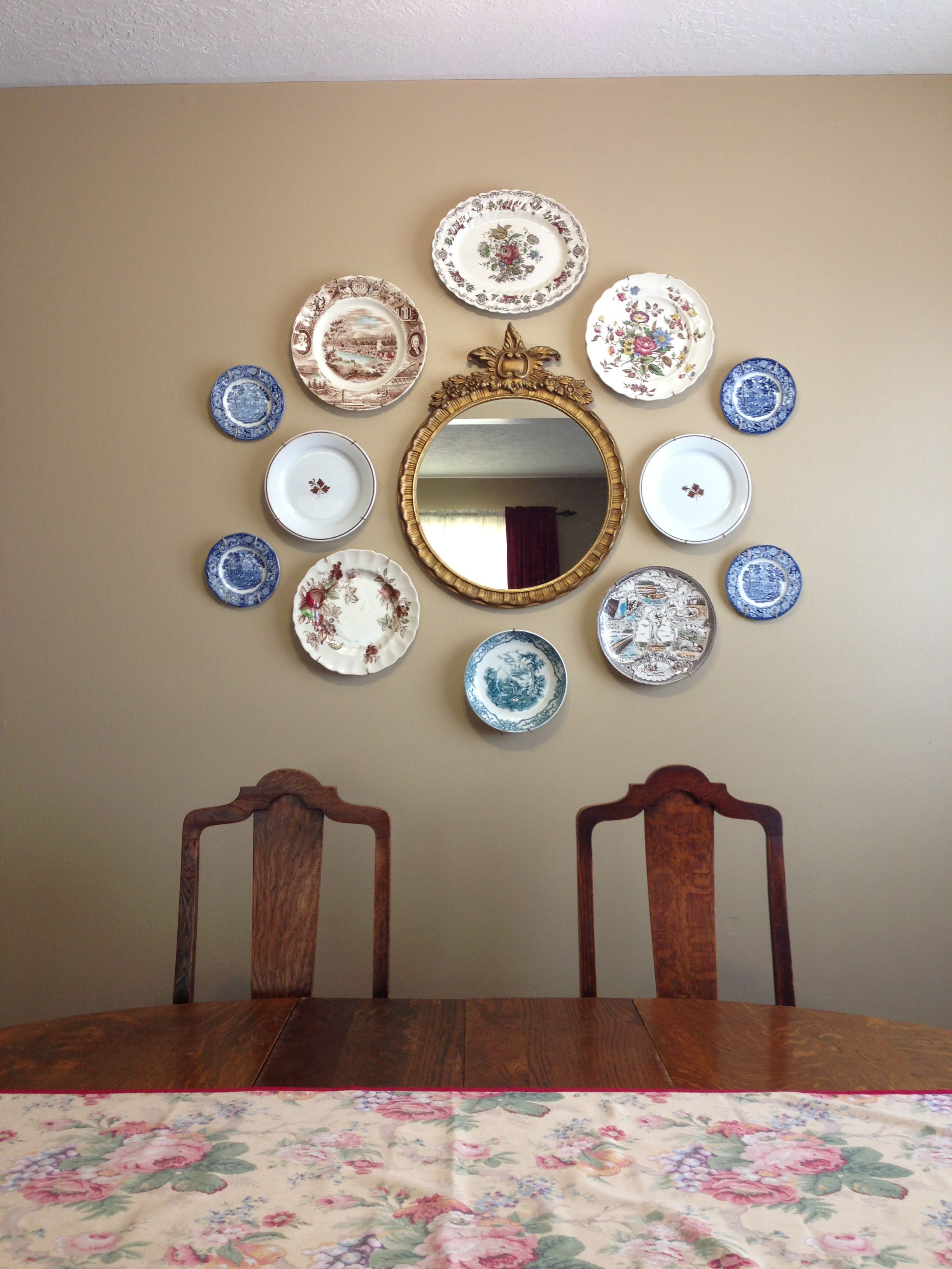 Plates and mirror on dining room wall paint is benjamin moore