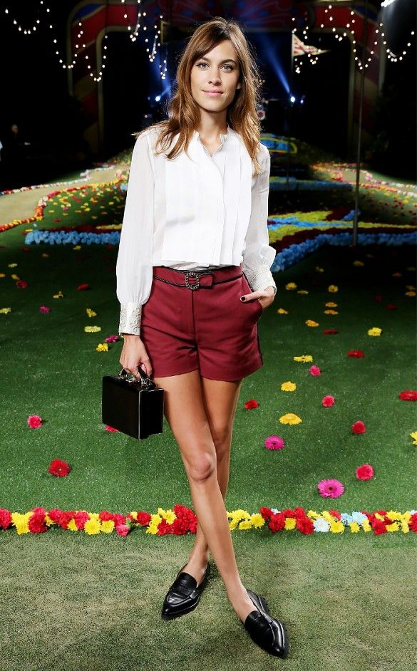 02b2aae2c0b Alexa Chung opts for a pressed look with a crisp blouse tucked into  deep-red shorts and loafers.     Celebrity