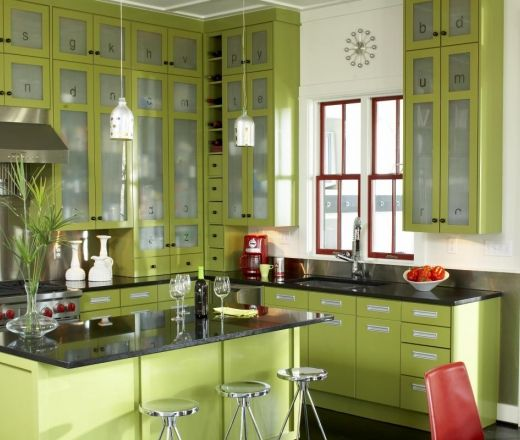 Modern Island Style Kitchen Tall Apple Green Cabinets Were Custom Built To Accentuate The Room S Kitchen Colors Green Kitchen Designs Interior Design Kitchen
