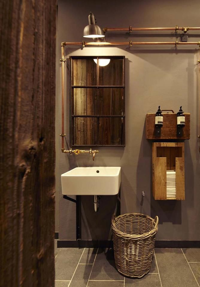 Industrial Bathroom Decorating Ideas the restroom is decorated in warm brown tones, photo © katrin