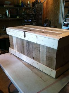 Use versatile pallet wood to build a rustic hope chest. Could keep outdoor pots/dirt/seeds in