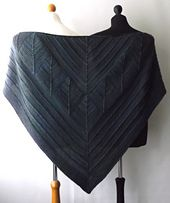 This shawl is created by knitting the centre section first. Then picking up stitches either side of this section to create the top and bottom sections. Detailed written instructions and pictures help you to create an unusual but interesting garment.