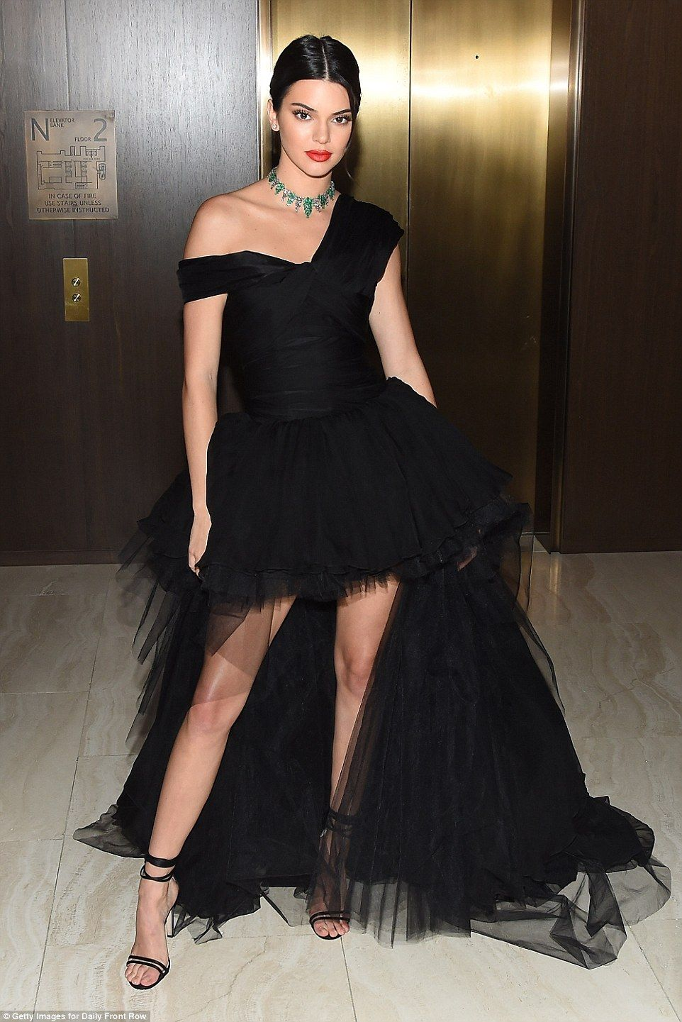 11f96d6d742e Kendall Jenner wows in black gown with emerald jewelry and red lips ...