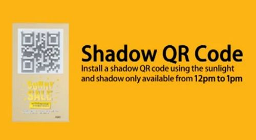 """Interesting concept - advertises a """"sunny sale"""" - QR code only becomes visible/activated by a shadow between 12-1pm"""