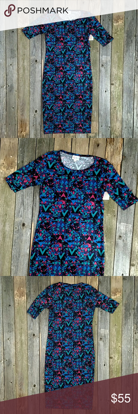"Lularoe Julia Dress NWT Super cute pattern!!! A dress that feels like a T-shirt. 39"" shoulder to hem and 15"" armpit to armpit. No trades! LuLaRoe Dresses Midi"