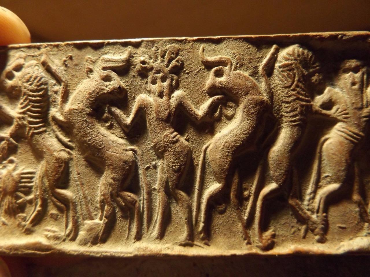 Sumerian cylinder seal impression - Master of animals. Museum replica.