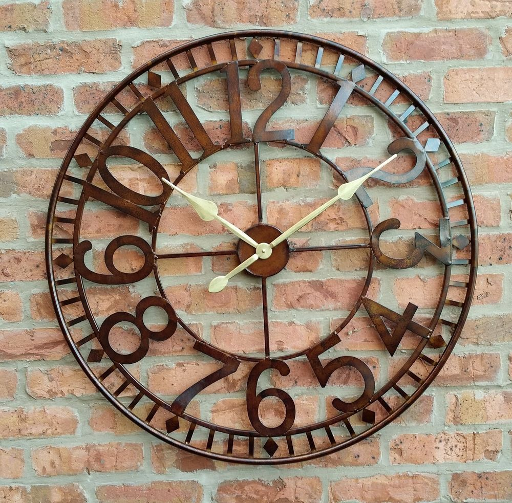 This Clock Has An Antique Rust Effect With A Round Face And Will Look Attractive In Any Garden Large Outdoor Wall Clock Large Outdoor Clock Outdoor Wall Clocks