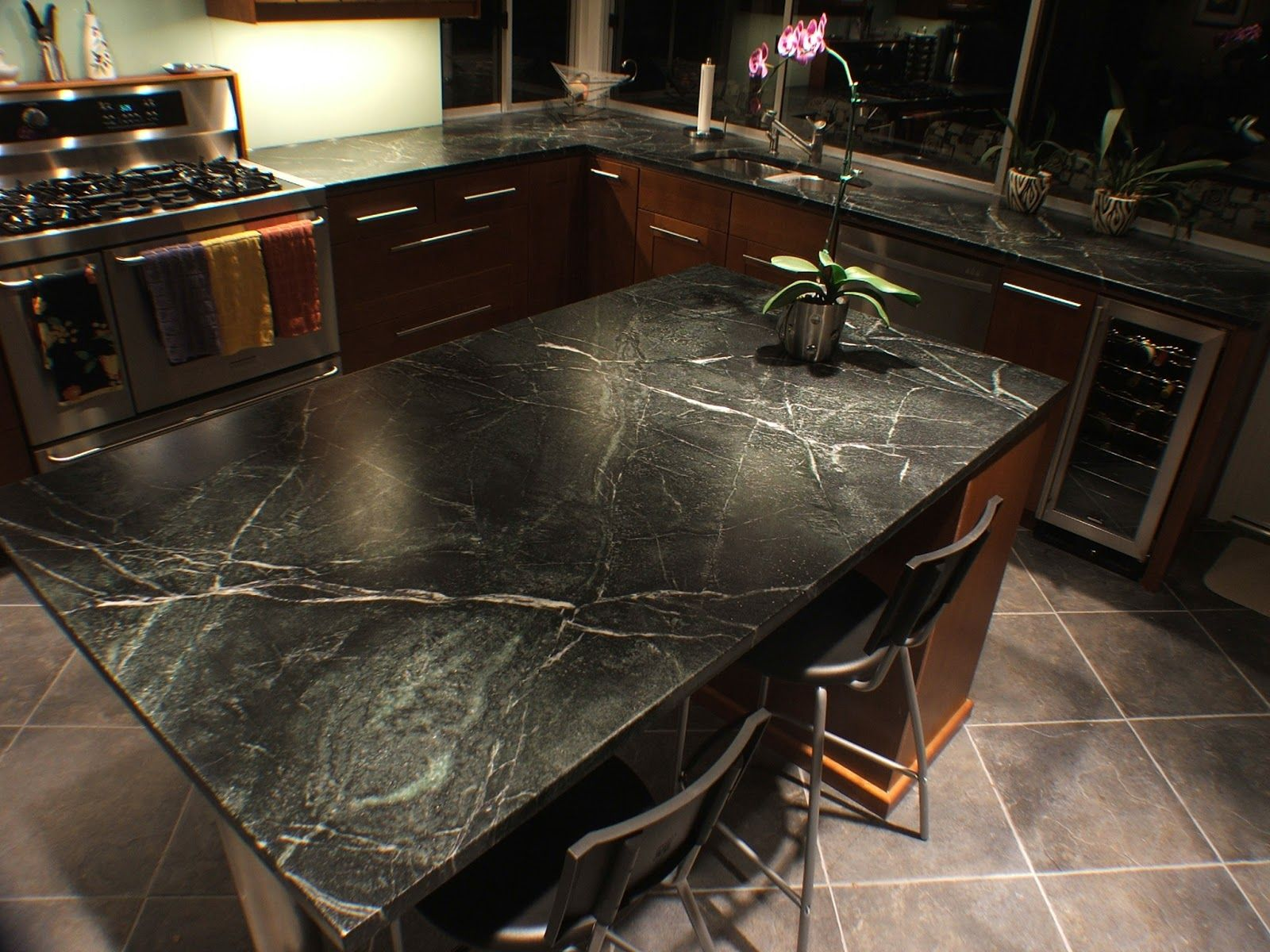 Soapstone no oil soapstone maintenance is fast easy mid classy black like granite patterns soapstone countertops with brown polished kitchen cabinet on diagonal gray tile floors in midcentury kitchen ideas doublecrazyfo Gallery