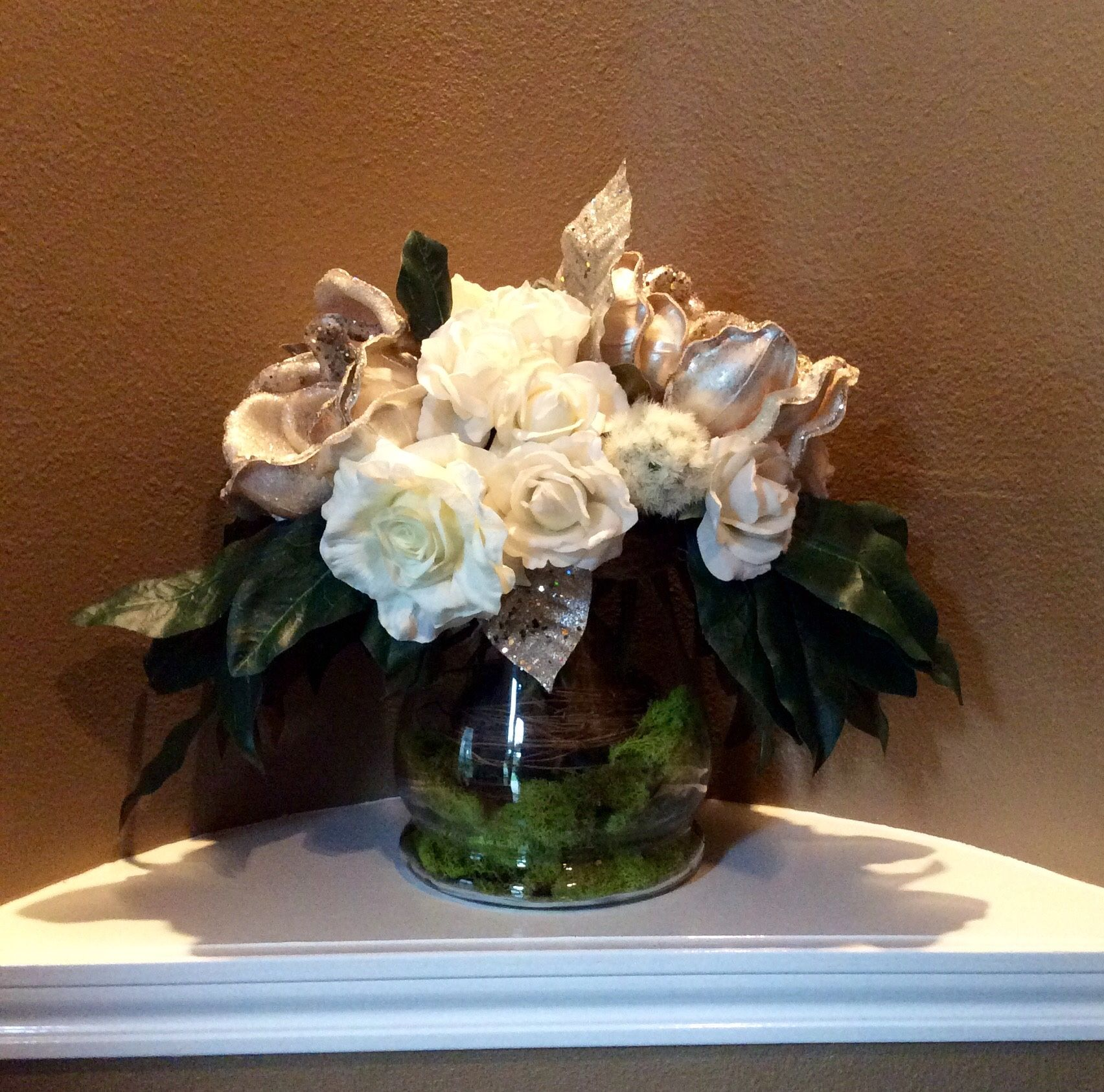 Silver magnolias and white real touch roses faux arrangement