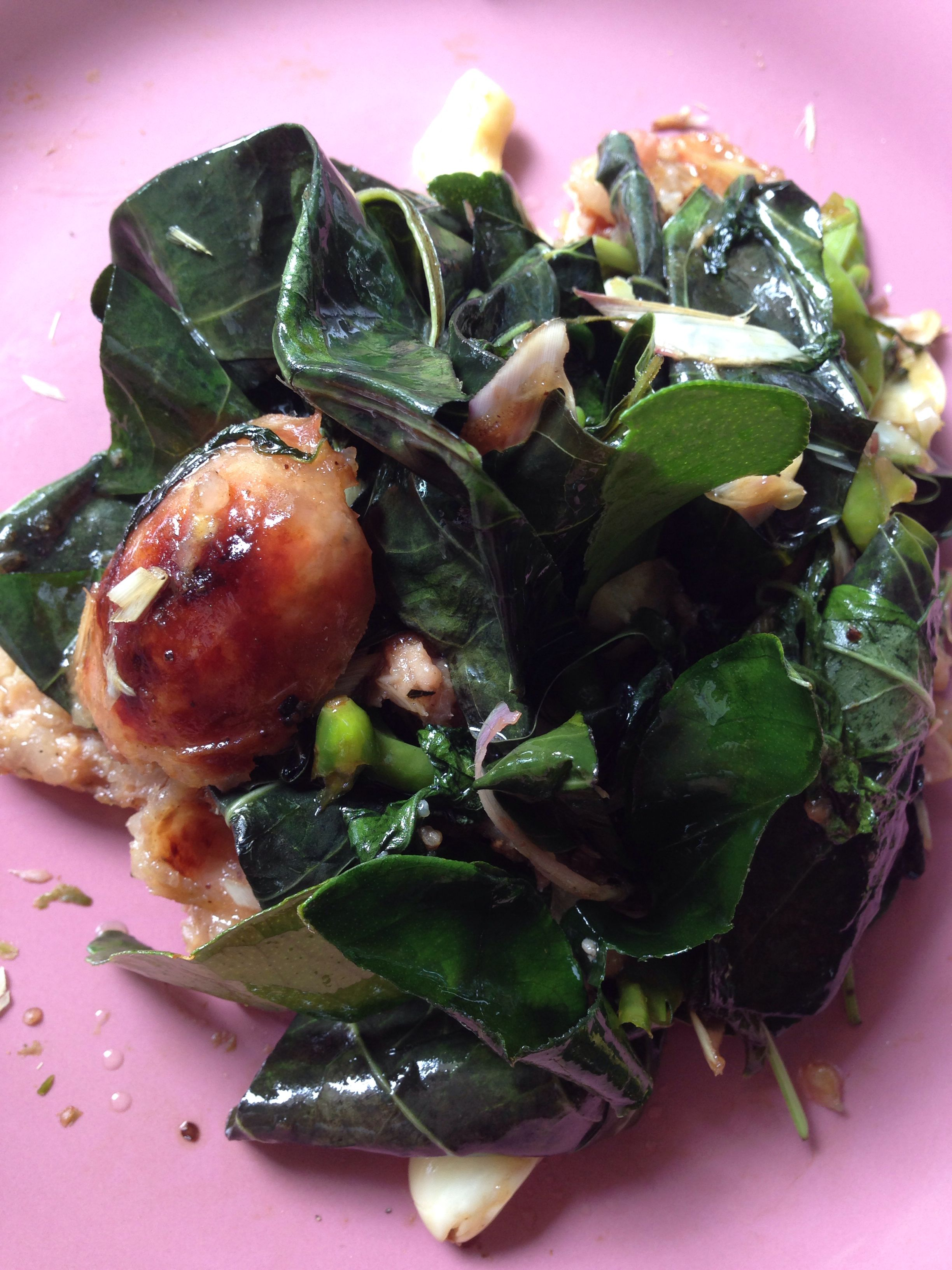 Stir-fried Thai spicy sausage with great morinda leaves (in my garden).