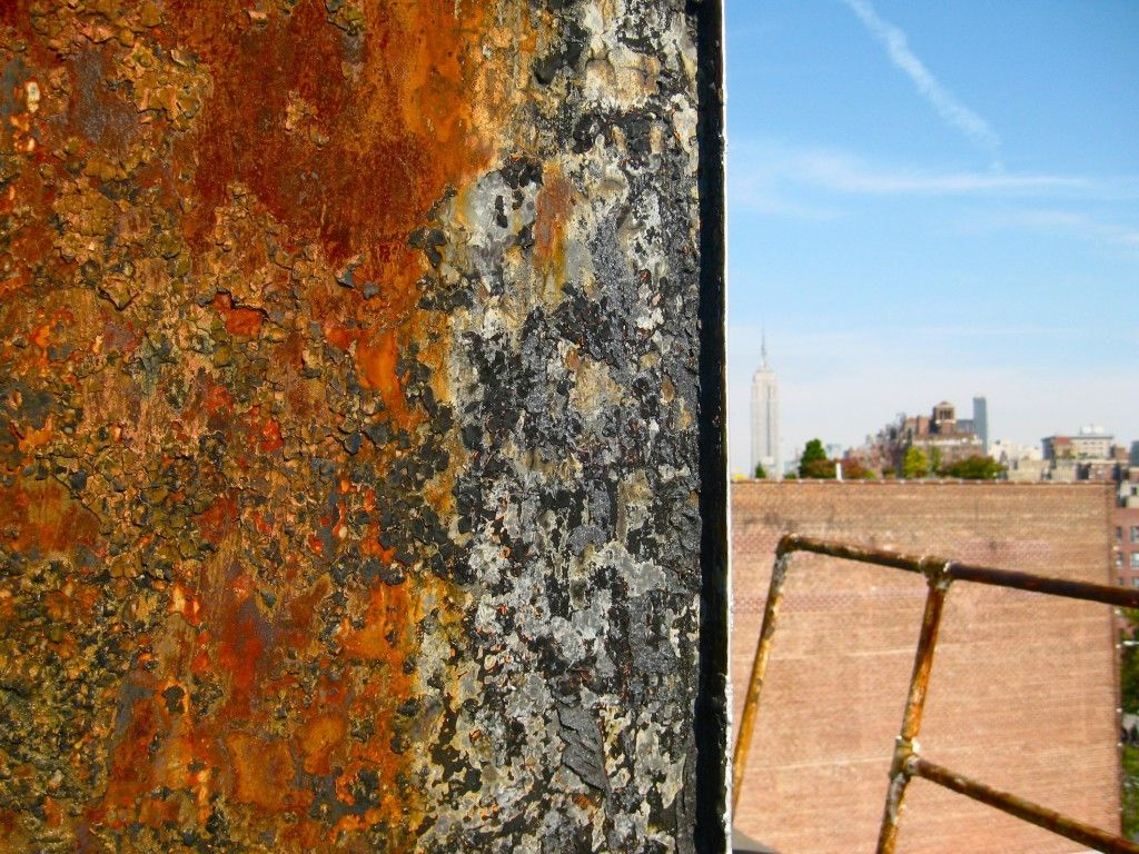 Rooftop Rust, Empire State Building in Distance | NYC