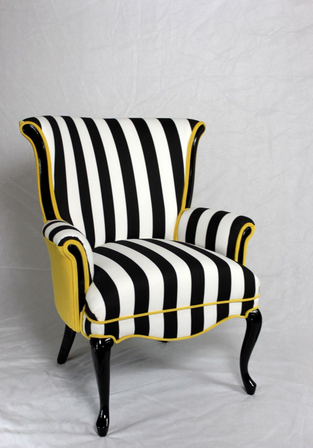 An Old Fashioned Chair With A Stuffy Shape Is Reinvented This Black And White Striped Fabric The Color Curator Photo