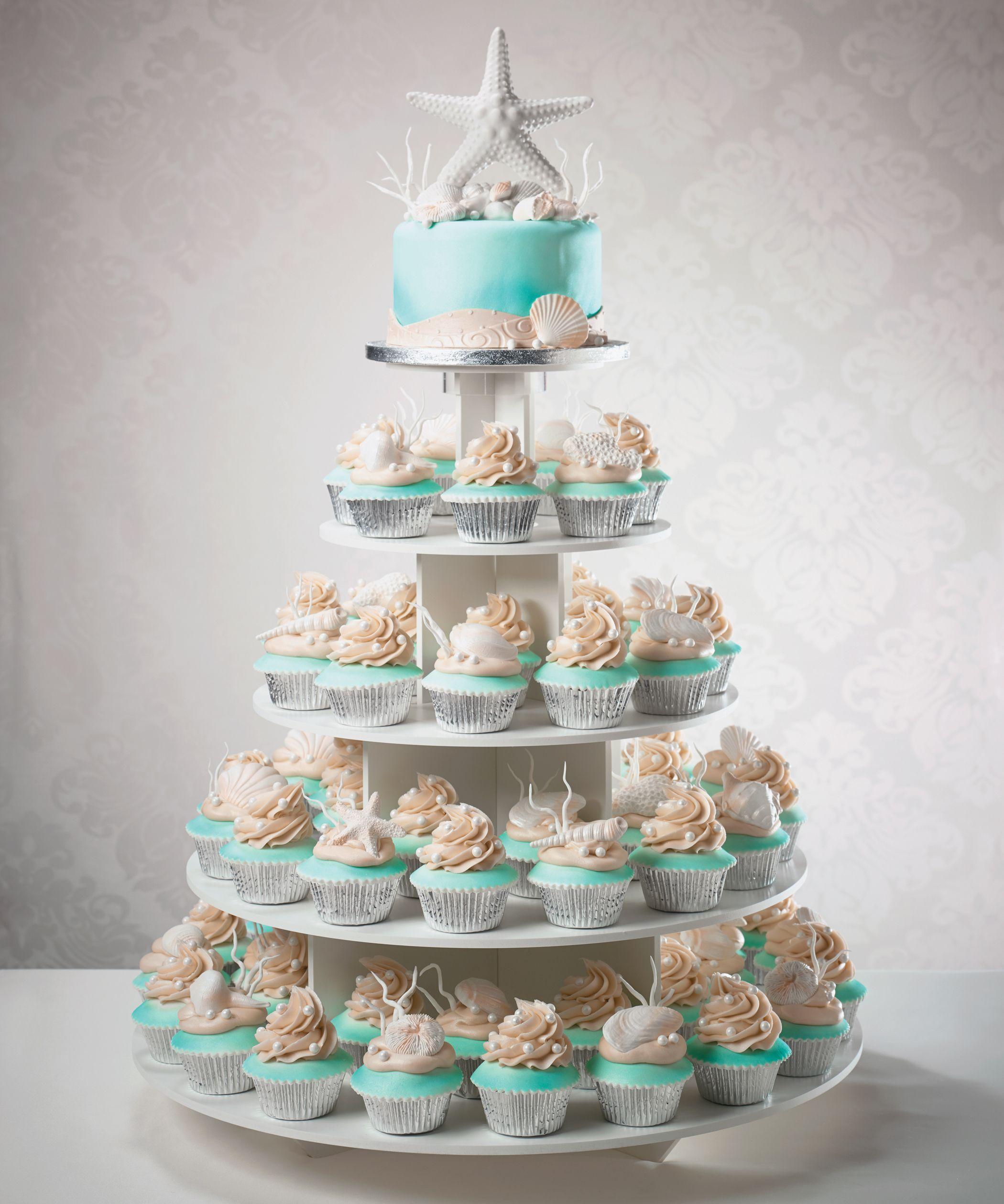 Wedding cake and cupcake tower for a beach destination wedding my