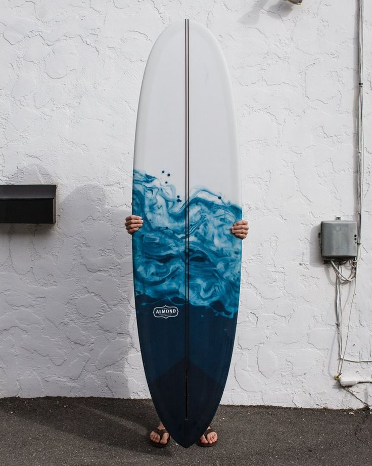 Here's a new Joy for the racks at 1720 Santa Ana Ave... 7'0 Joy model with a clear deck and blue swirl resin abstract on the bottom. This is modeled after our coffee+milk resin swirl boards, but with a more ocean-inspired deep blue.  Resin is interesting because when the fiberglass cloth is laid out across the board, whichever color goes down first will saturate the cloth, and essentially