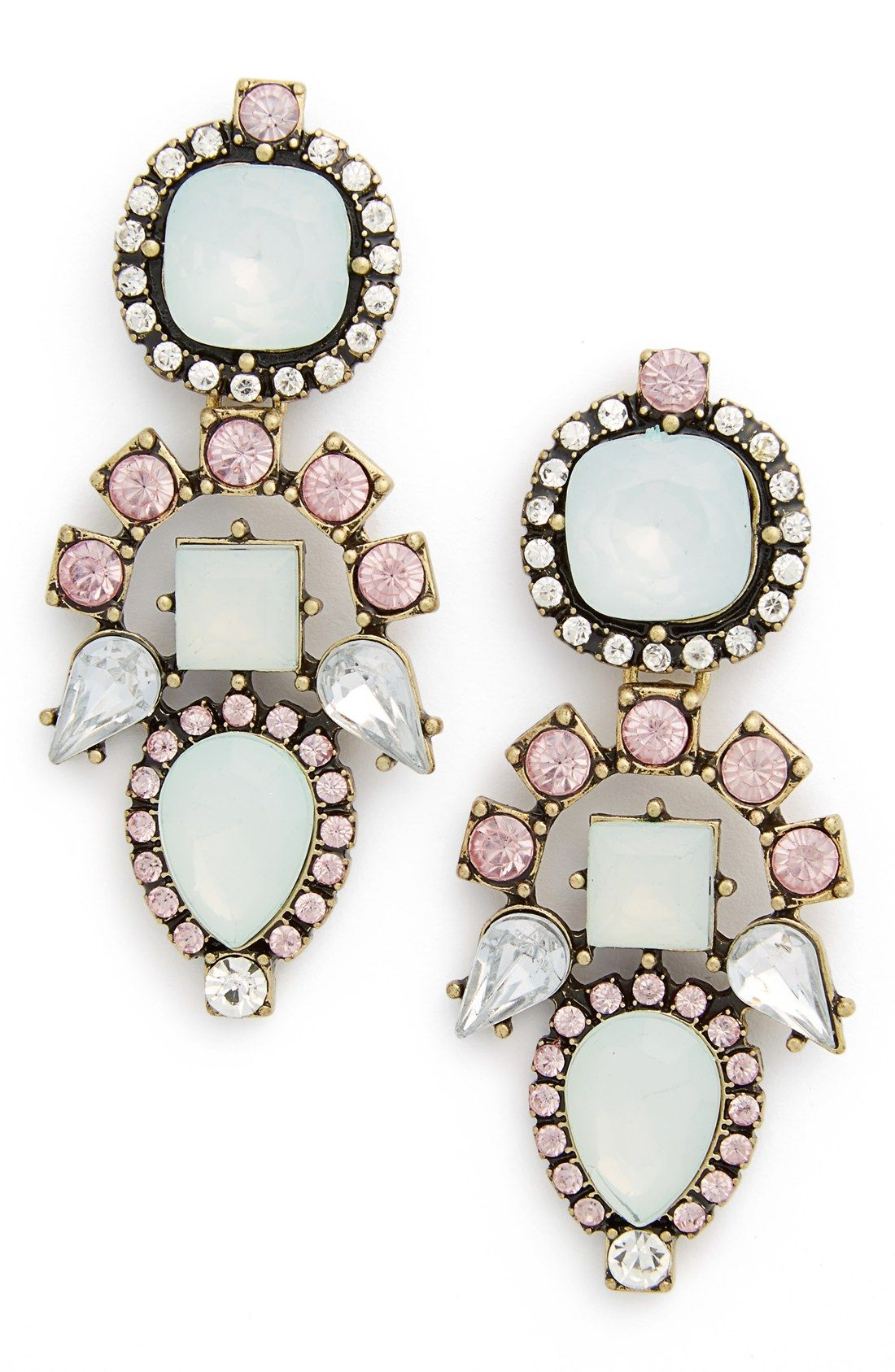 Clusters of faceted pink multi stones sparkle on statement-making earrings perfect for finishing off a glam look.