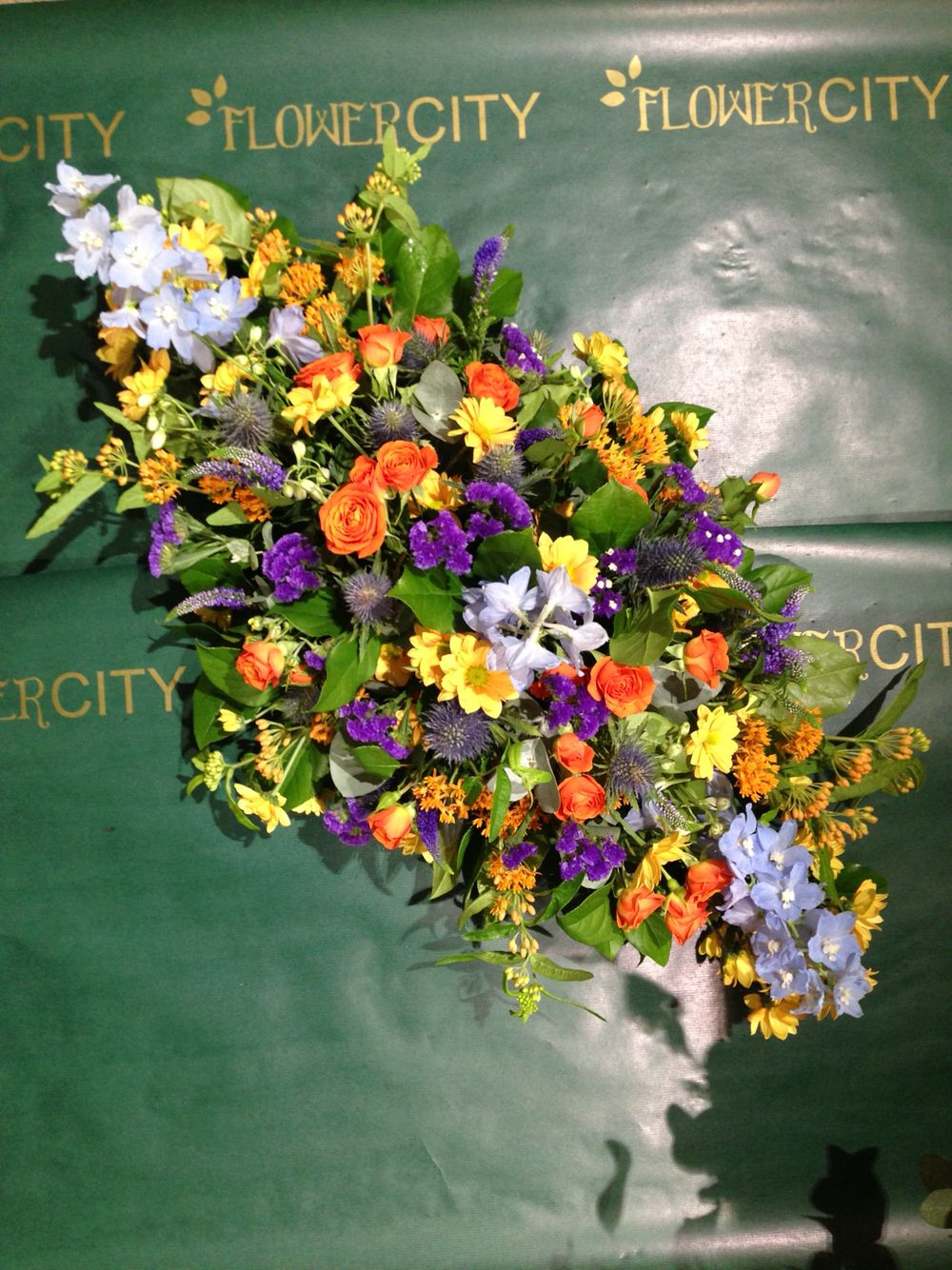Lovely Funeral Spray In Customers Choice Of Oranges And Blues