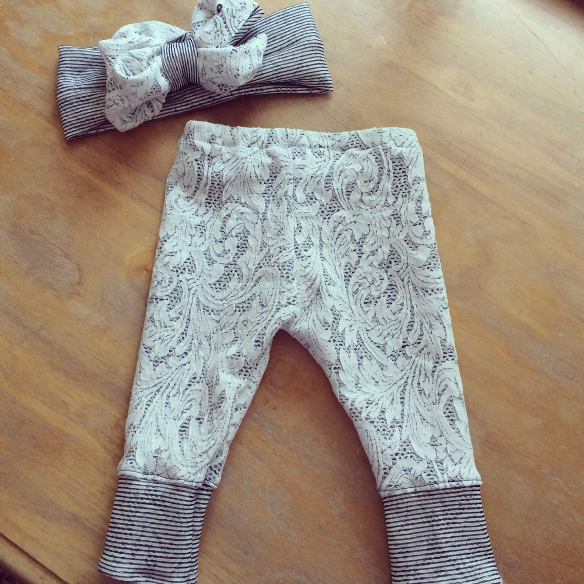 Knit leggings and a messy bow! Love the lace look!