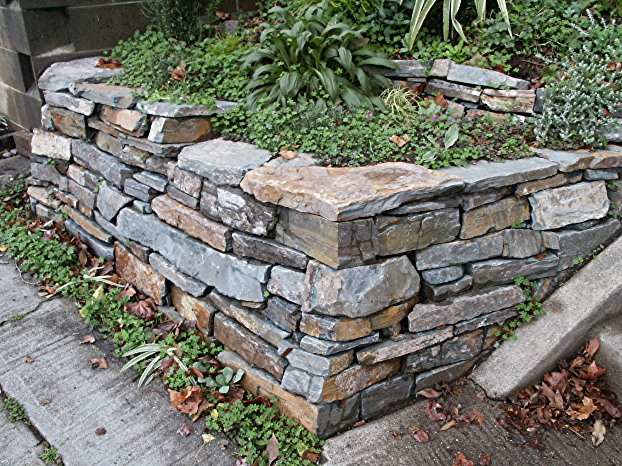 Landscaping Ideas With Stone : Landscaping with stone wall corner l huls designs