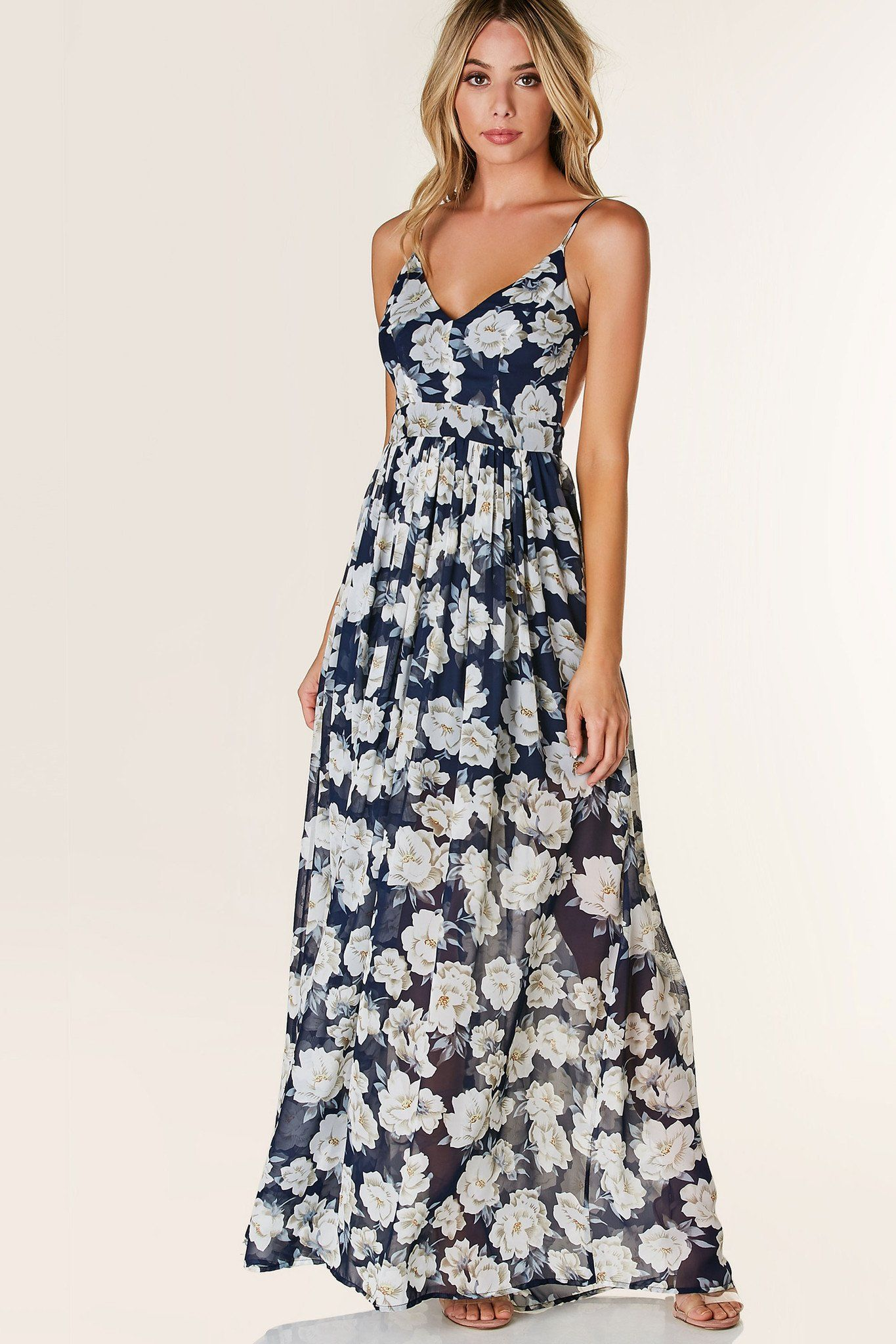 961d6dd53be Gorgeous V-neck maxi dress with adjustable shoulder straps and open back.  Fully lined with floral print throughout and hidden side zip closure.