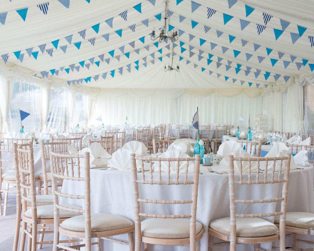 Colorful pennant banners add a whimsical touch to this nautical ...